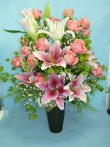 Kütahya güvenli kaliteli hızlı çiçek  cam vazo içerisinde 21 gül 1 kazablanka