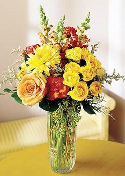 Kütahya çiçekçi telefonları  mika yada cam içerisinde karisik mevsim çiçekleri