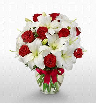 Kütahya çiçek servisi , çiçekçi adresleri  1 dal kazablanka 11 adet kırmızı gül vazosu